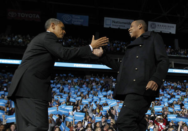 President Barack Obama is greeted on stage by rapper Jay-Z at an election campaign rally in Columbus, Ohio the day before the election.