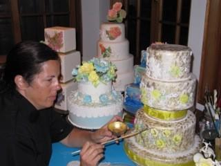 Judy Haron of Gateau et Cuisine creates custom cakes that are hand painted and applied with sugar flowers and accents.