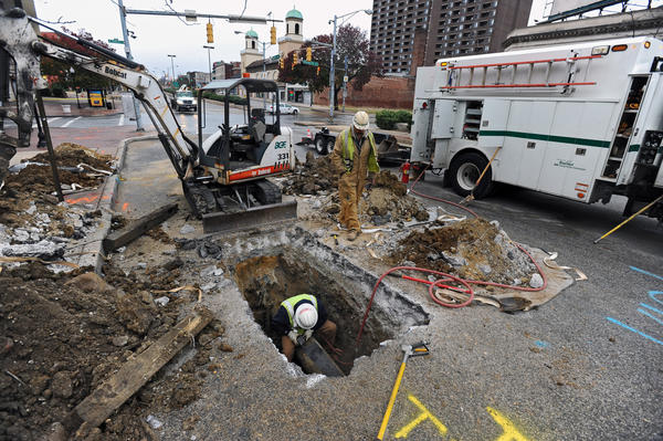 A BGE work crew works on cleaning a pipe that is adjacent to the major water main break at Charles Street and North Avenue. The breakage caused the closure of Charles Street for blocks since Wednesday morning.