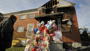 Combustible materials stored too close to a furnace burst into flames and caused the October rowhouse fire that claimed five lives, Baltimore fire officials said Thursday.