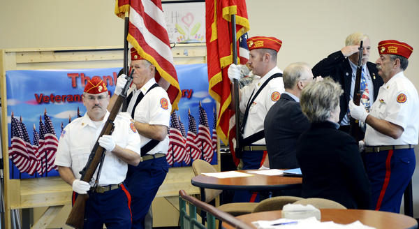 Chuck Martin leads Marine Corps League Antietam Detachment members Don Muffley, Mike Nakopoulos and William Reel in the Presentation of Colors at the Veterans Day Celebration held at Hagerstown Community College Thursday morning in the Student Center.