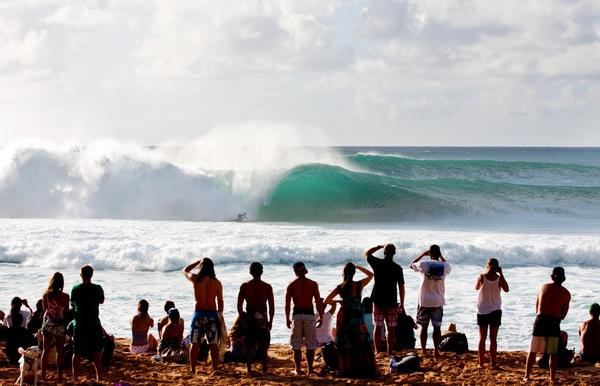Spectators take in one of the competitors in Van's Triple Crown of Surfing on Oahu's North Shore. This year's competition begins next week.
