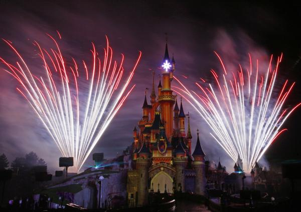 The Walt Disney Co. reports that its net income in the latest quarter rose 14% thanks to an uptick in revenue driven by higher consumer spending at its theme parks and on its cruise ships.