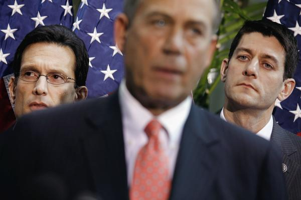House Majority Leader Eric Cantor, left, and House Budget Committee Chairman Paul Ryan flank House Speaker John Boehner at a news briefing in May.