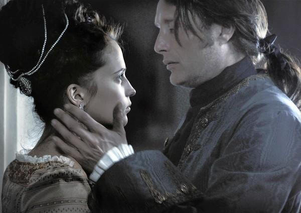 "Alicia Vikander and Mads Mikkelsen star in ""A Royal Affair."""