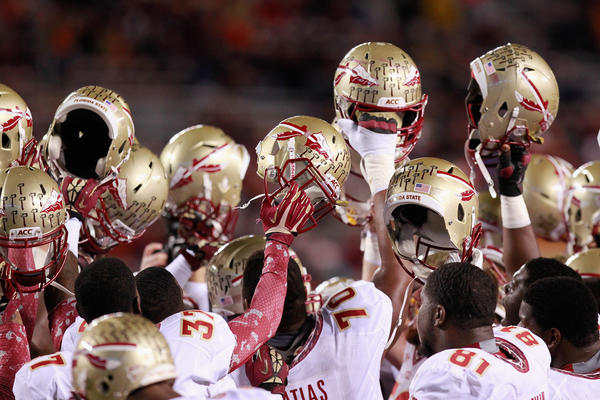 Players of the Florida State Seminoles huddle prior to their game against the Virginia Tech Hokies at Lane Stadium on November 8, 2012 in Blacksburg, Virginia.