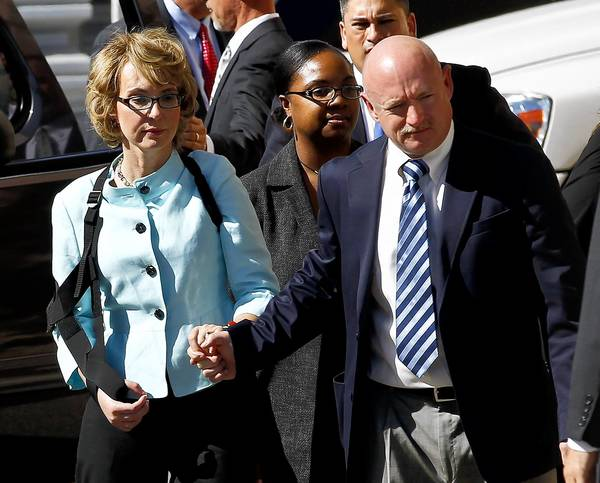 Former Rep. Gabrielle Giffords and her husband, Mark Kelly, leave after the sentencing of Jared Lee Loughner.