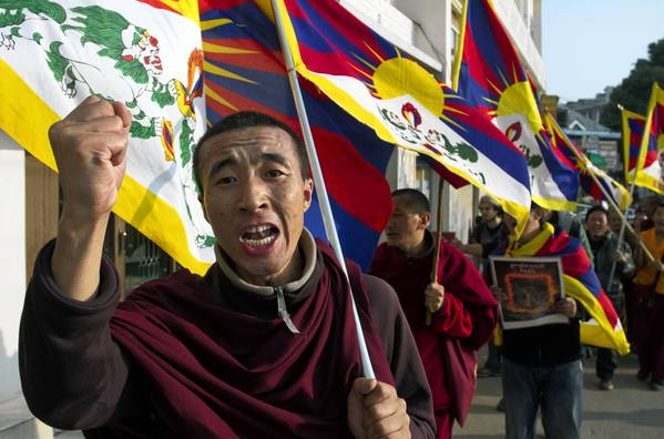 A Tibetan exile shouts slogans during a demonstration in Dharamsala, India, to show solidarity with Tibetans who immolated themselves to protest Chinese rule.