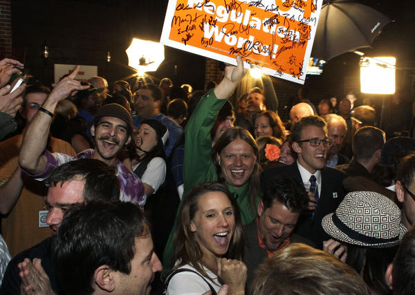 Amendment 64 supporters celebrate after a local television station announced the marijuana amendment's passage, in Denver, Colo.