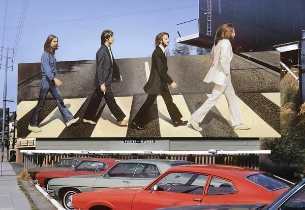 "A 1969 billboard advertises the Beatles' album ""Abbey Road."""