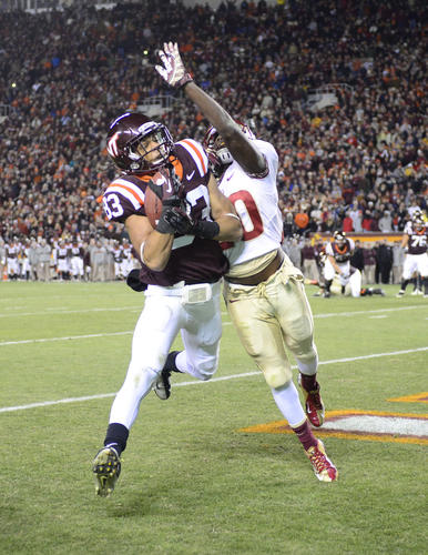 Virginia Tech Hokies wide receiver Corey Fuller (83) makes a touchdown catch as Florida State Seminoles defensive back Lamarcus Joyner (20) defends in the second quarter at Lane Stadium.