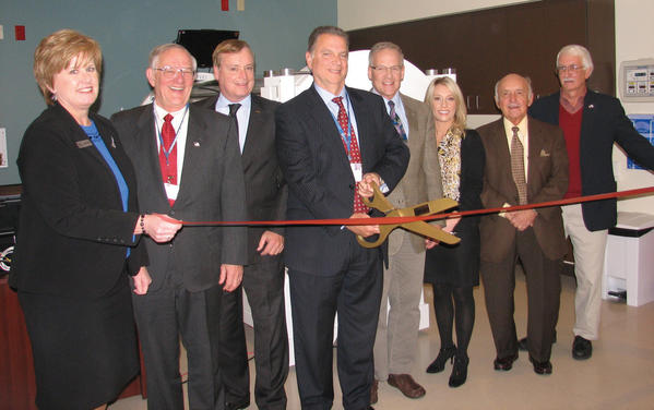 Participating in Thursday's ribbon cutting for West Virginia University Hospitals-East's new Center for Wound Care and Hyperbaric Medicine at City Hospital are from left, Tina Combs, Martinsburg Berkeley County Chamber of Commerce; William Stubblefield, Berkeley County Council; Rick Pill, WVUH-East board of directors; Anthony Zelenka, chief administrative officer, City Hospital; Dr. Robert Bowen, medical director, Center for Wound Care and Hyperbaric Medicine; Ginna Reep, RN, director of the Center for Wound Care & Hyperbaric Medicine; Martinsburg Mayor George Karos; state Del. Walter Duke.