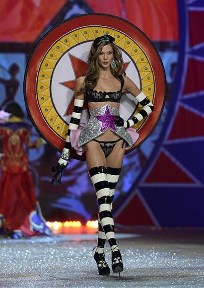 Bedazzled bras and half-clad circus acts: Welcome to the Victoria's Secret fashion show: Karlie Kloss is the knife thrower.