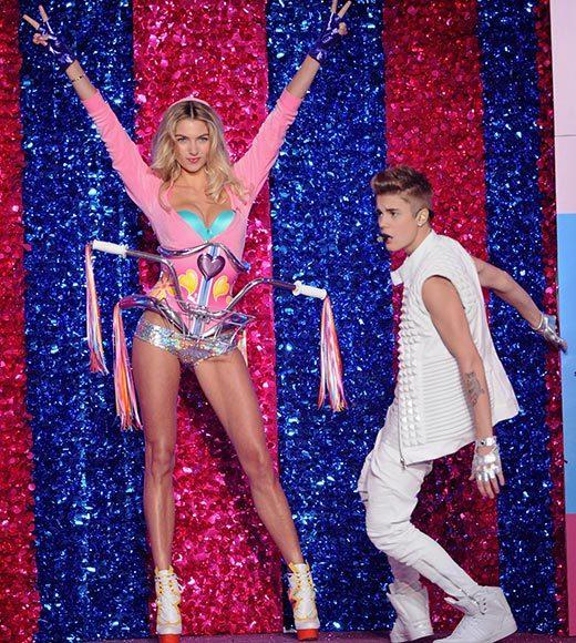 Bedazzled bras and half-clad circus acts: Welcome to the Victoria's Secret fashion show: Jessica Hart tempts Justin Bieber to get on his bike.