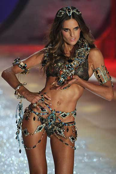 Bedazzled bras and half-clad circus acts: Welcome to the Victoria's Secret fashion show: Izabel Goulart is the snake-charmer.