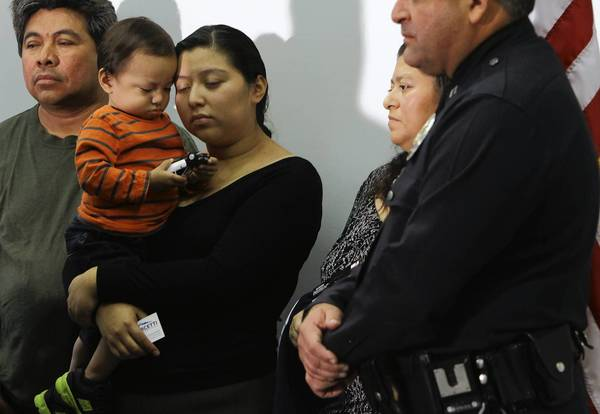 The family of slain Andres Ordonez -- left to right, his father-in-law Cirilo Mendez, his son Nehemias Andres Ordonez, his wife Ana Mendez and the boy's grandmother, Ana Mendez -- attend a news conference at LAPD's Rampart Station. At right is LAPD Capt. Steven Ruiz.