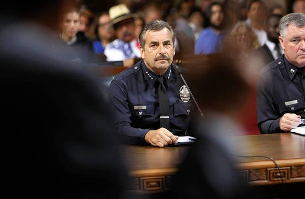 Los Angeles Police Chief Charlie Beck, shown before the L.A. City Council in July, warned Thursday that police officers will be in danger of layoffs unless the city proceeds with a ballot measure to increase its sales tax by a half-cent.