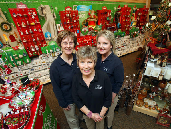 Janet Anderson, owner of Anderson Hallmark, center, with store managers Diane Ligtenberg, left, and Jill Cutler, right.