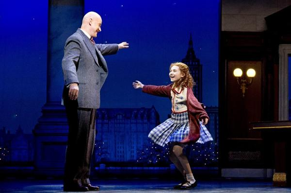 "Anthony Warlow and Lilla Crawford cavort as Oliver Warbucks and Annie in a scene from the Broadway revival of ""Annie."""