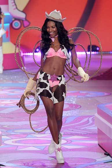 Bedazzled bras and half-clad circus acts: Welcome to the Victoria's Secret fashion show: Sharam Diniz breaks out the cowgirl gear. Those are singularly ineffective chaps.