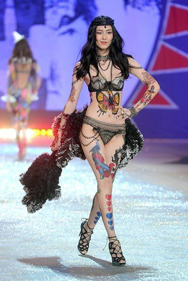 Bedazzled bras and half-clad circus acts: Welcome to the Victoria's Secret fashion show: Liu Wenis the tattooed lady