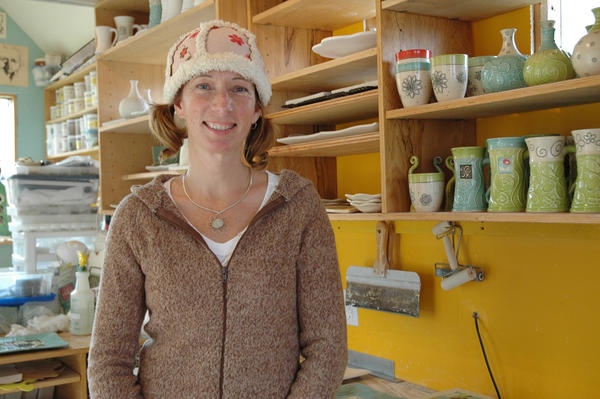 Petoskey artist Kim Krumrey helps make bowls to donate for the Empty Bowls Project.