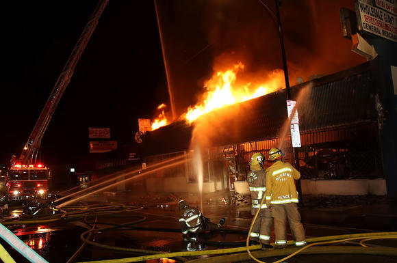 Firefighters battle a blaze on Victory Boulevard in Burbank.
