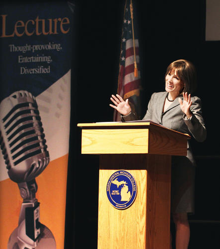 Olympic gymnast Shannon Miller gives a motivational presentation on setting goals and promoting health, Thursday evening at the North Central Michigan College gymnasium in Petoskey. Miller, who was part of the 1996 Olympic gold medal team in Atlanta, remains the most decorated American gymnast, male or female, in history.