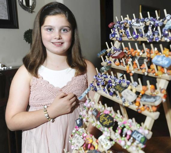 Timonium resident Cailie Ziegler, 10, won the 2012 Kids Helping Hopkins Children's Champion award for donating the proceeds to the center from bracelets she makes and sells.