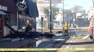 Firefighters mop up the major early morning fire on Friday.