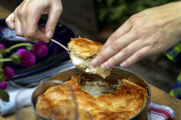 Karen Hatfield serves the potato and mushroom goat cheese gratin en croute.