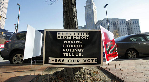 A sign advertising the protection of voter rights is posted outside a polling site in Cleveland. A county in Alabama is challenging a provision that requires much of the South to get advance approval from Washington before making changes in election laws or voting rules.