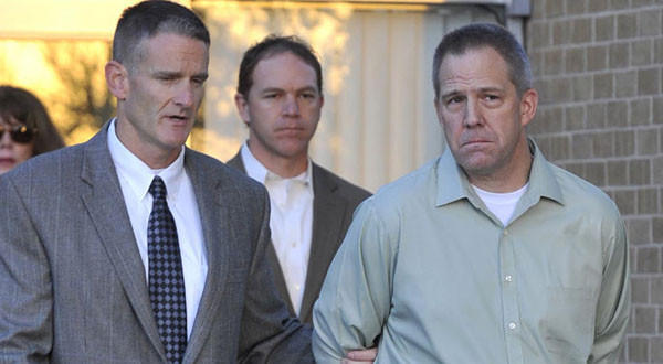 JetBlue pilot Clayton Frederick Osbon, right, is escorted to a waiting vehicle by FBI agents in Amarillo, Texas.