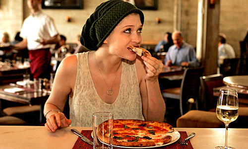 Olivia Fox enjoys the pizza at Riva.
