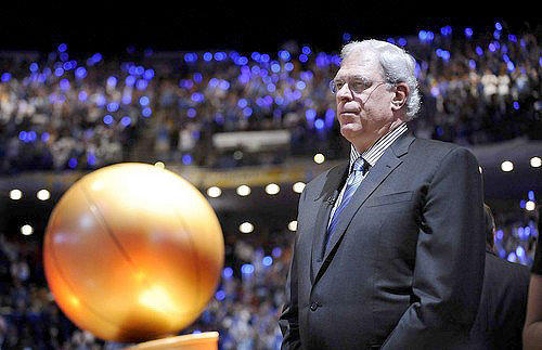 Phil Jackson with the NBA championship trophy.