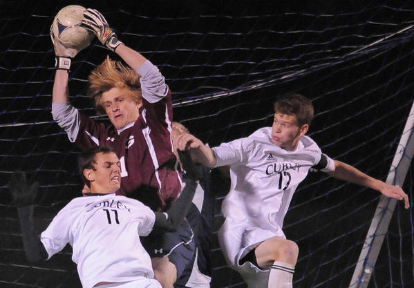 Gilman's goalie #1 Chase Wittich stops this late game goal shot by Curley's #11 Nick York on a corner kick. Also shown is Curley's #17 Eric Spalt. Gilman takes on Curley in MIAA soccer semifinal, with Gilman taking the 2-1 win.