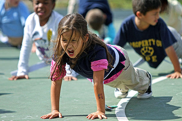 First-grader Mia Harrison, 6, counts out pushups during taekwondo class at Coral Park Elementary in Coral Springs on Friday, Nov. 9, 2012. The school has received taekwondo classes from Park's Martial Arts as they gear up for a kick-a-thon in December to raise money for their school.