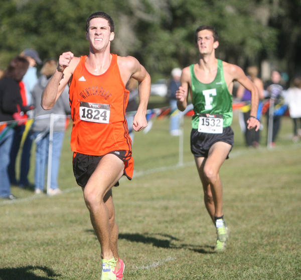 Winter Park's John Lindsey (#1824) finshes sixth and Flagler Palm's Thomas Carroll (#1532) finshes seventh in the FHSAA Class 4A, Region 1 Cross Country Championship at Sante Fe Community College in Gainesville, Florida on Friday, Nov. 9, 2012.