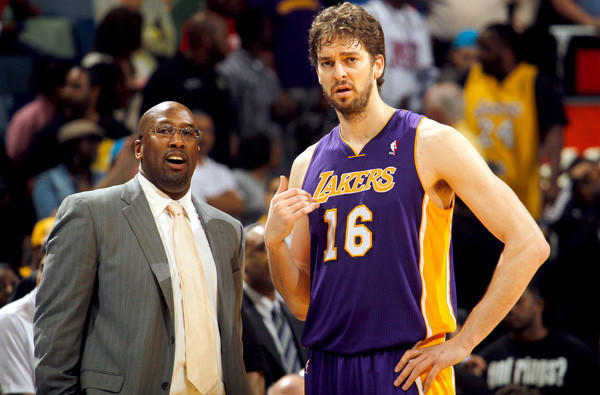 Lakers power forward Pau Gasol chats with Mike Brown during a timeout in a game against the New Orleans Hornets last season.