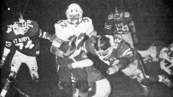 St. Mary defenders Mike Sysko (74) and Larry Pung (52) attempt to stop an Inland Lakes runner in the Oct. 31, 1986, contest. In the final game of the season, the Snowbirds defeated the Bulldogs 14-0 to finish the year on a four-game winning streak and one game over .500 at 5-4.