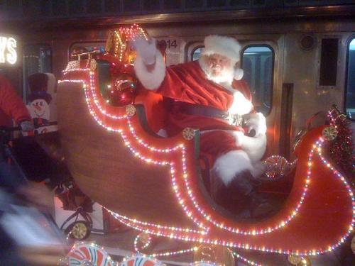 Santa waves to CTA riders.