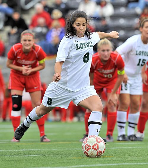 Loyola's Gigi Mangione kicks the soccer ball in a recent match.