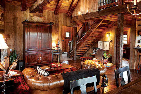 "At Sandhill, north woods style doesn't give an inch on luxury -- the cabin comes with its own sauna and poker ""shack"" with a fireplace and full bath. Not to mention that snappy red roof."