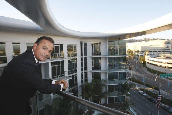 Developer Rick Caruso at his 8500 Burton Way apartment and retail complex in Los Angeles.