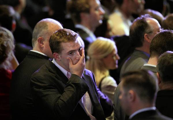 A dismayed Republican crowd reacts at the Boston Convention Center on election night as the race is called for President Obama.