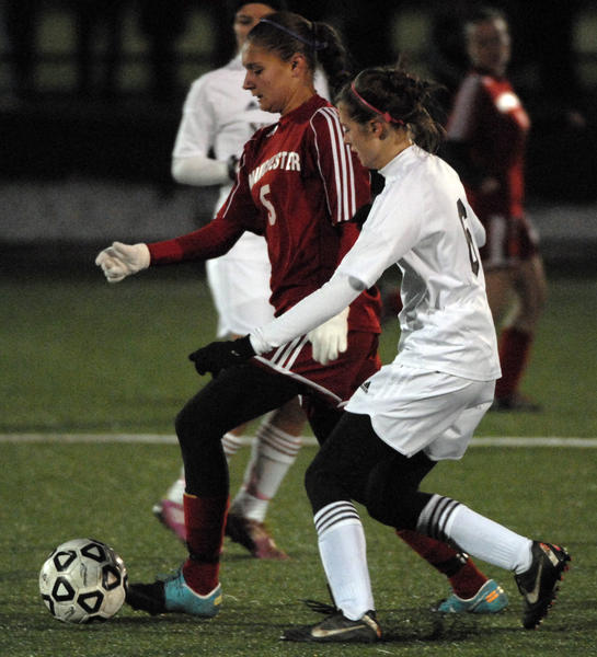 Manchester's Ashley Feshler, 5, and Naugatuck's Emma Colucci, 6, battle for the ball in the second half. Manchester High School beat Naugatuck High School in the first round of the 2012 CIAC Class LL Girls Soccer Tournament played at FSA in Farmington.