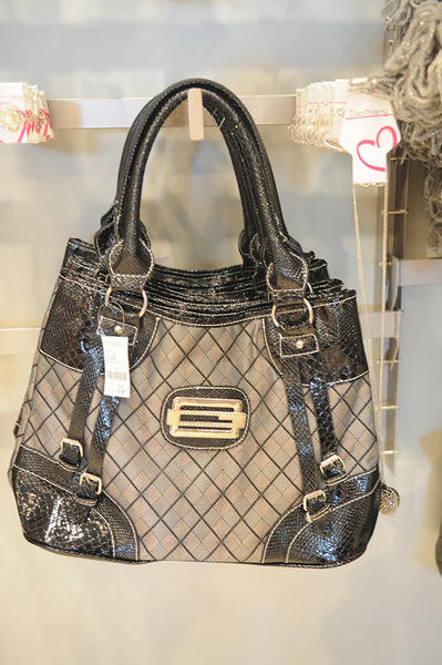 One of the many stylish handbags they sell at the new Discovery Clothing, a discount trendy clothing store, which opened its third South Florida location Friday in Davie.