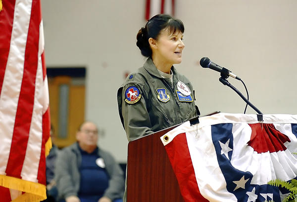 Sharon Webb, a flight nurse for 167th Air National Guard speaks at Veterans Day program held at Spring Mills Middle School on Friday morning.