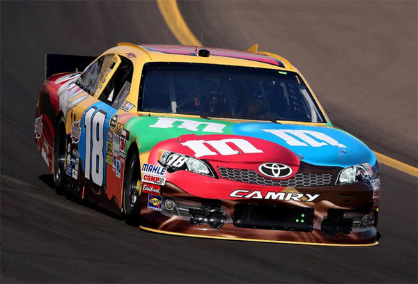Kyle Busch set a track qualifying record of 138.766 mph to win pole position.