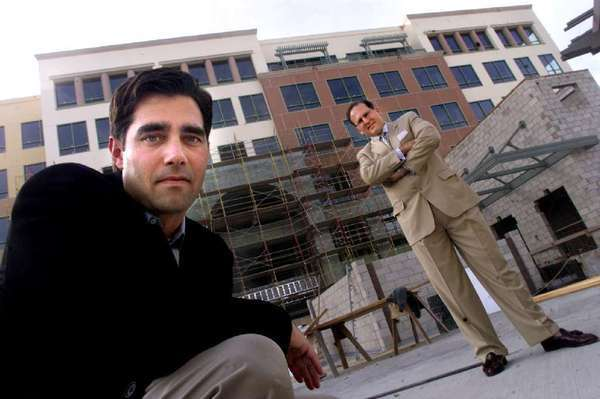 Developer Jeff Worthe, left, and real estate broker Carl Muhlstein during construction of the Pinnacle in 2002.